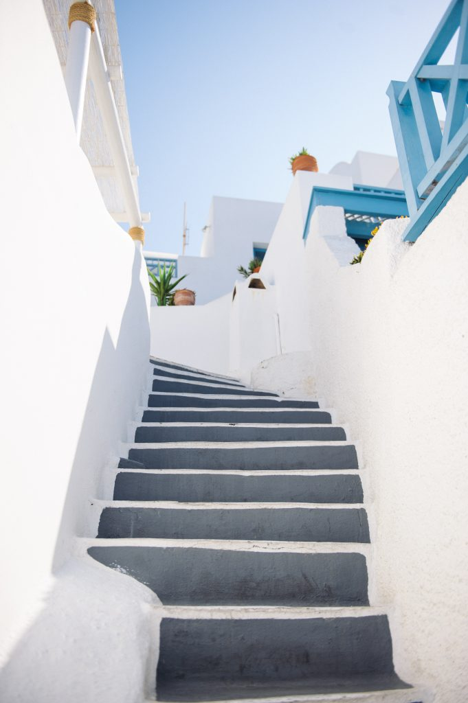 Stairways between white walls lead out of fear of failure