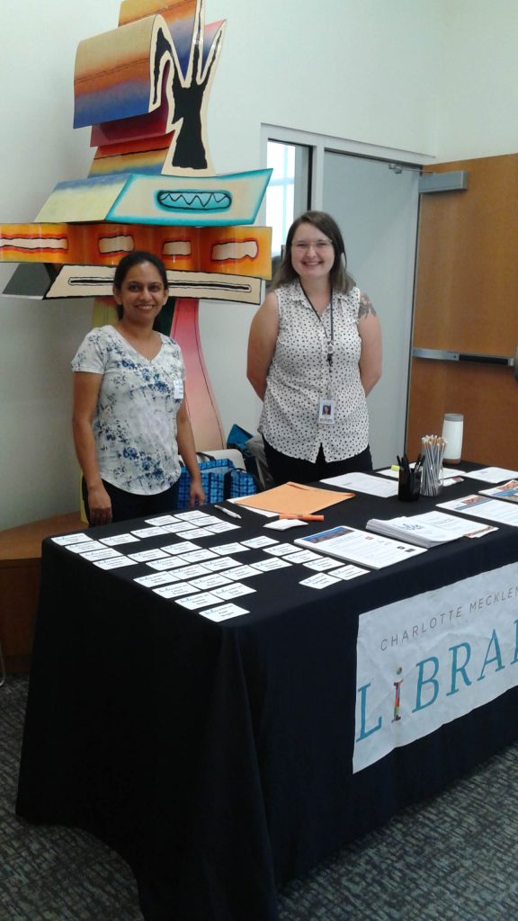writer interview partner Sourabhi with colleague in front of a welcome desk