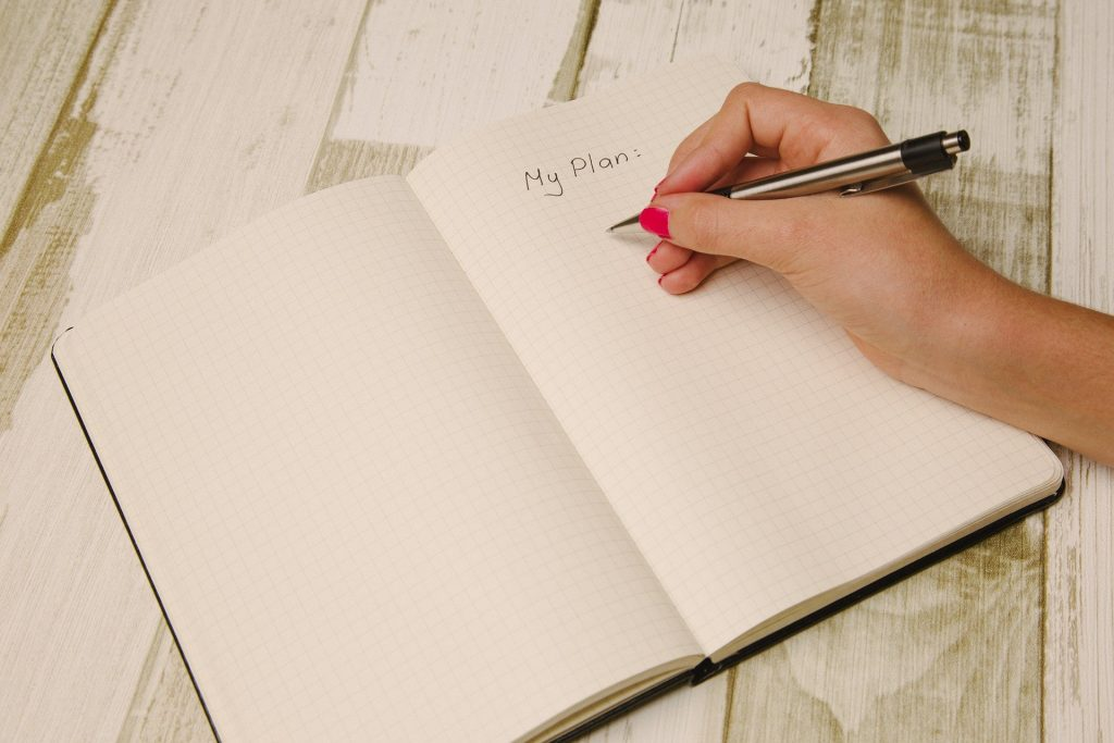 journal with a writing hand