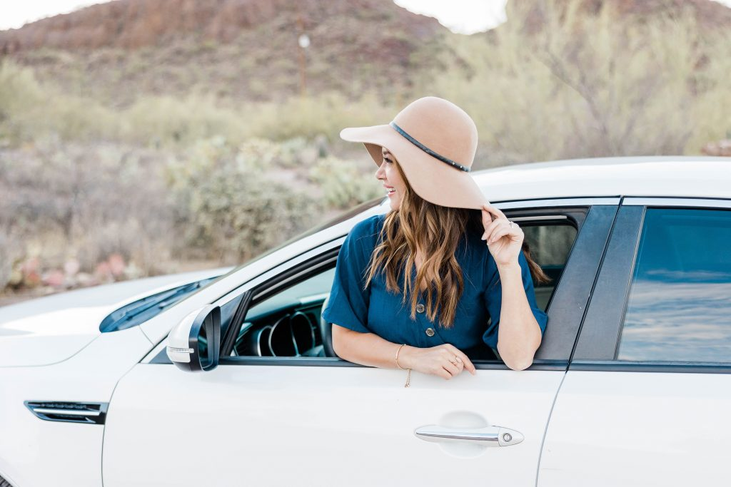 girl looking out of a car. She looks forward with confidence
