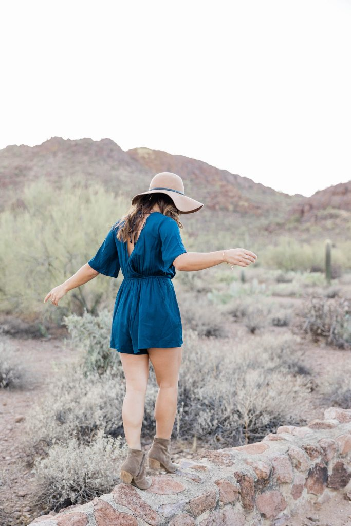 girl stepping on stones in a desert to show how to change although it is hard