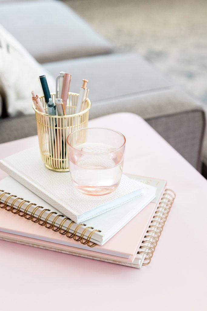 Glass on journals show how to build good habits and track the progress